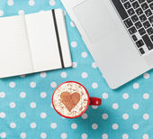Cappuccino with heart shape and laptop with note — Stock Photo