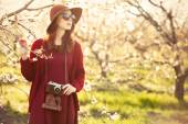 Woman with camera in apple tree garden — Photo