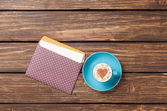 Cup of cappuccino with heart shape — Stock Photo