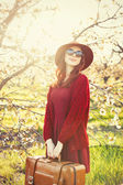 Woman in red sweater and hat with cup — Stock Photo