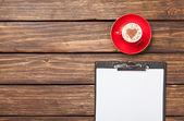 Cappuccino and business tablet — Stock Photo