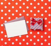 Gift box and envelope — Stock Photo