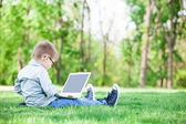 Boy with a books and laptop computer — Stock Photo