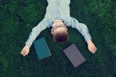 Young boy with a book slipping  — Stock Photo
