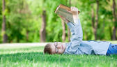 Young boy with a book — Stock Photo