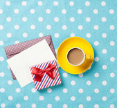 Cup of coffee and envelope  — Stock Photo