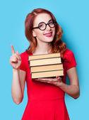 Chica en vestido rojo con libros — Foto de Stock