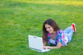 Girl with laptop computer and notebook — Stockfoto