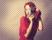 Portrait of redhead  woman with retro camera — Stock Photo
