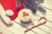 Cup of coffee and christmas candy — Stock Photo
