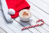 Cup of coffee and Santas hat — Stock Photo