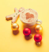 Coffee and gingerbread with christmas bubbles — Stock Photo