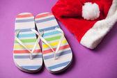 Santas hat and flip flops — Stock Photo