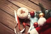 Christmas bubbles and Santas hat — Stock Photo