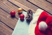 Santas hat and chrsitmas bubbles — Stock Photo