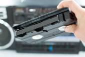 Plastic, black videotape in hand  — Foto Stock