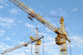 Construction of the new brick building by means of the elevating crane — Stock Photo