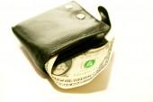 Black purse with dollar  — Stock Photo