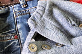 Texture - Textile: blue jeans and a wool sweater  — Stock Photo