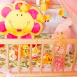 Cots with different soft toys — Stock Photo #57113177