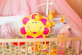 Cots with different soft toys — Stock Photo
