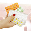 Different pharmaceutical tablets in women's hand — Stock Photo #64200431