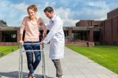 Young doctor assisting a young woman — Stock Photo