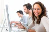 Young attractive woman working in a call center — Stock Photo
