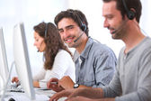 Young attractive man working in a call center — Stock Photo