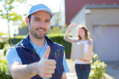 Delivery man succeed during his delivery — Stock Photo