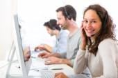 Young attractive woman working in a call center — Foto de Stock