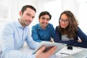 Young serious couple meeting a real estate agent — Stock Photo