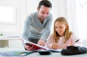Father helping out her daughter for homework — Stock Photo