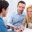 Young attractive couple signing contract on tablet — Stock Photo #57599001