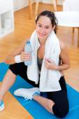 Woman drinking water after a sport session — Stock Photo