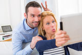 Young attractive couple having fun doing selfie — Foto de Stock