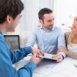 Young attractive couple signing contract — Stock Photo #58141453