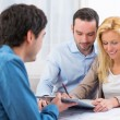 Young attractive couple signing contract — Stock Photo #58141473