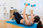 Young attractive girl doing exercise at home — Photo