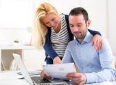 Attractive couple doing administrative paperwork — Stock Photo