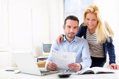 Attractive couple doing administrative paperwork — Stockfoto