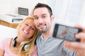 Young attractive couple having fun doing selfie — Foto Stock