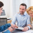 Young attractive couple signing contract — Stock Photo #58644561