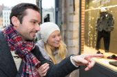 Young attractive couple doing some window shopping — Stock Photo