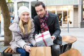 Young attractive couple putting gift in bags — Foto de Stock