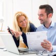 ������, ������: Attractive couple doing administrative paperwork