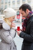 Young attractive man propose marriage to his love — Stock Photo