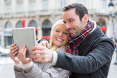Young couple on holidays taking selfie — Stock Photo