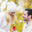 Young attractive man propose marriage to his love — Stok fotoğraf #59690385