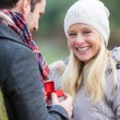 Young attractive man propose marriage to his love — Stockfoto #60256273